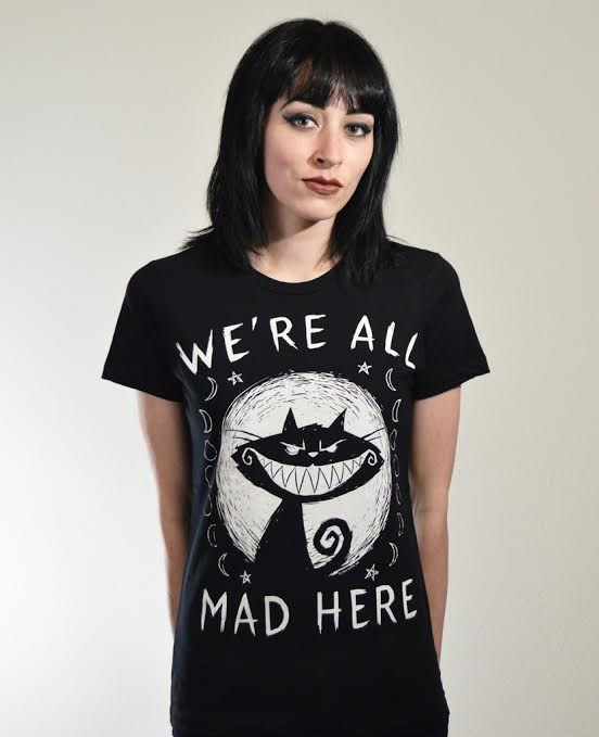 We're All Mad  - Cheshire Cat on a black girls shirt by Akumu Ink