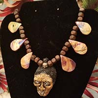 Shruken Head Handcrafted Tiki Necklace by The Stilettoed Devil - Orange Abalone