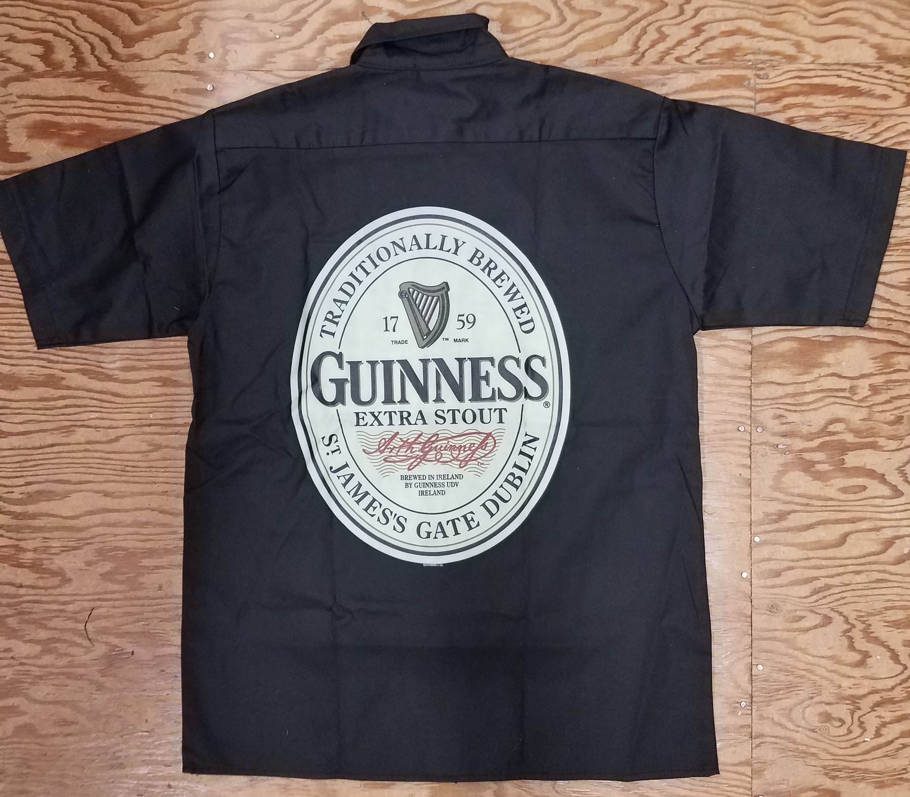 Guinness- Logo Embroidered on front, Label on back on a black button down work shirt (Sale price!)
