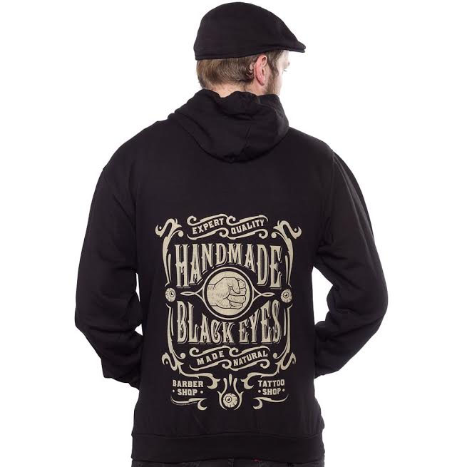 Logo On Front, Black Eyes on back on a black zip up hooded sweatshirt by Kustom Kreeps - SALE M & L only