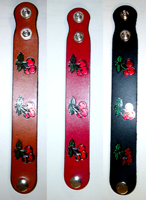 "Cherries on a leather bracelet (1"" wide)"