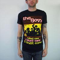 Boys- I Don't Care on a black ringspun cotton shirt