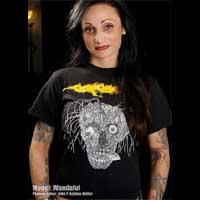Carcass- Face & Yellow Logo on a black shirt