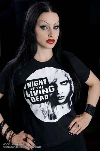 Night Of The Living Dead- Face In Circle on a black girls fitted shirt