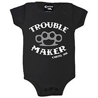 Trouble Maker Brass Knuckles on a black onesie by Cartel Ink